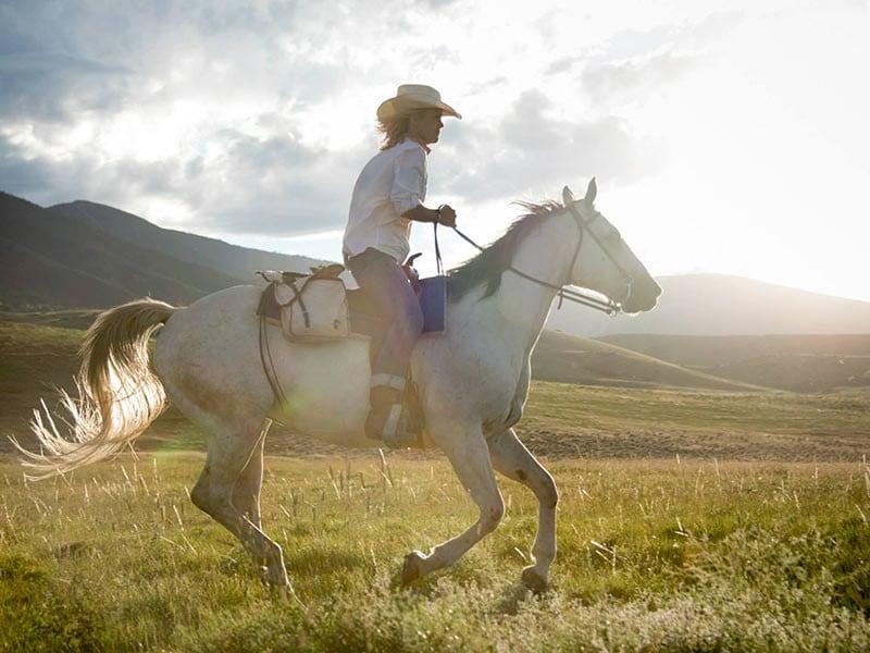 woman Horseback Riding in Wyoming