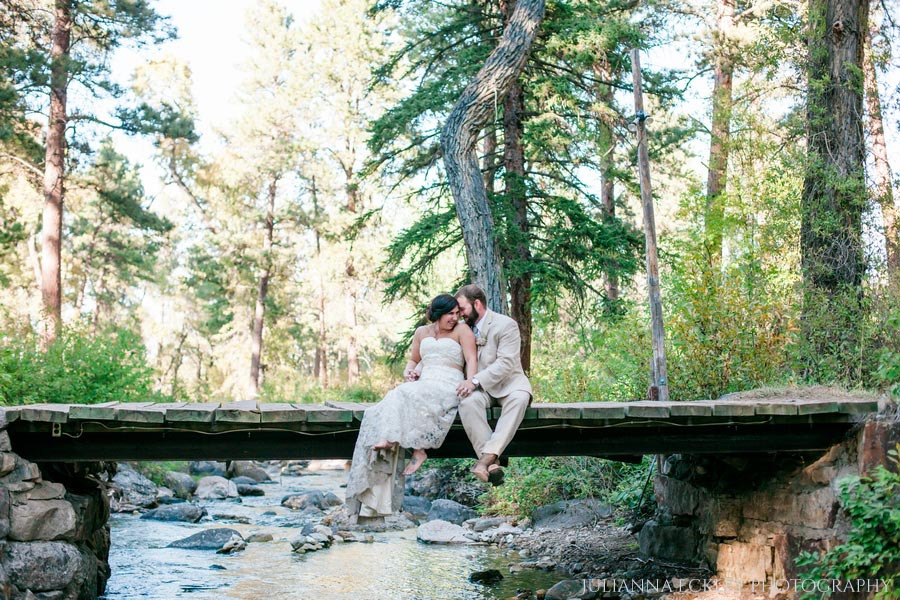 Sheridan WY Wedding Venues bride and groom over creek